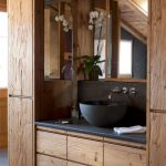 Rustic Bathroom Decor With Wood Cabinet And Black Stone Sink