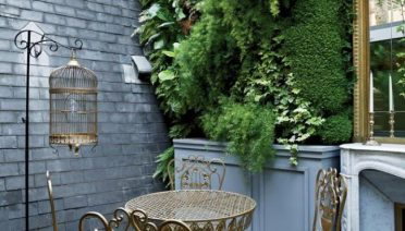 Small balcony with majestic Vertical garden decor design and gray bricks wall